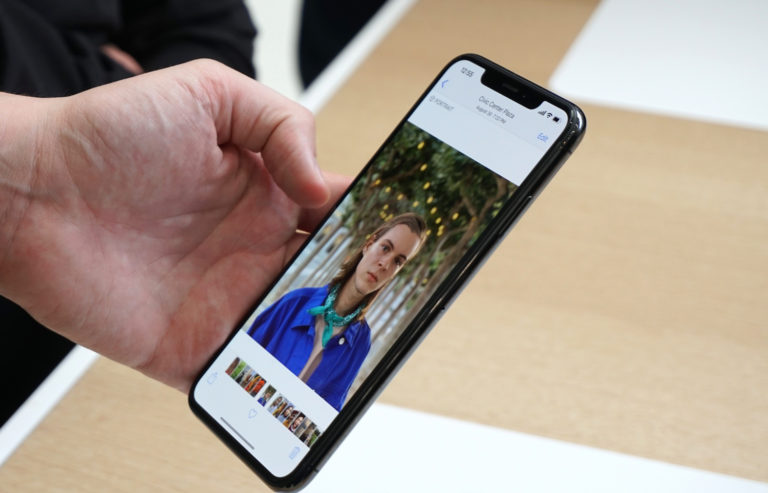 Picture of a hand holding an iPhone XS Max from the iPhone launch event.
