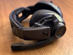 Picture of the Sennheiser GSP 670 gaming headphones placed on wooden desk